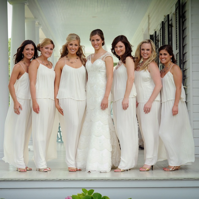 The bridesmaids wore flowing white draped dresses from Zara for a casual, summery look.