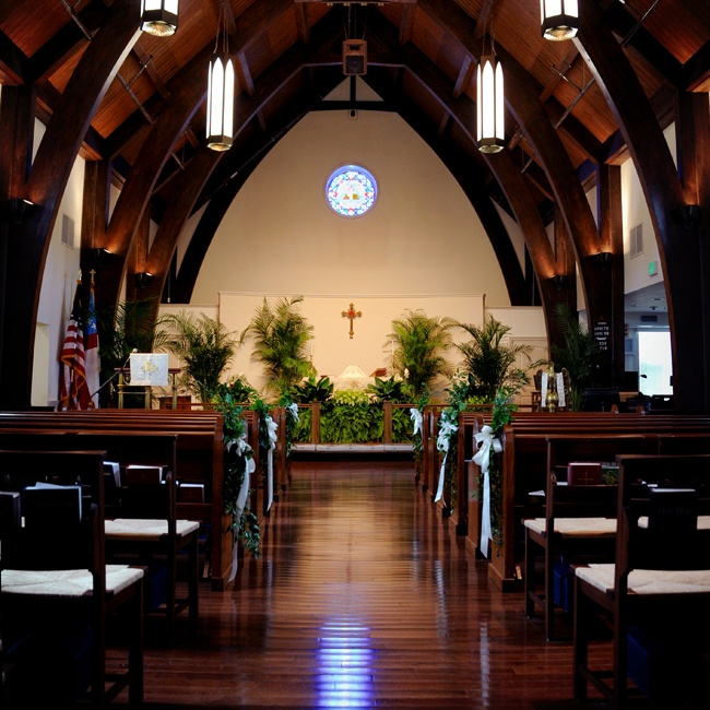 The couple held their ceremony at the Trinity Episcopal Church in Pass Christian. Lush green arrangements added a tropical feel to the space.