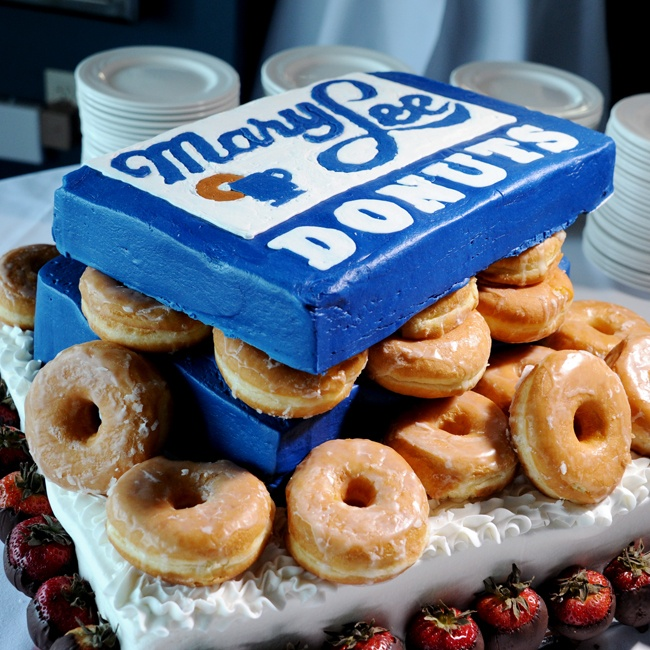 The couple chose a fun creative design for the groom's cake - a box of donuts!