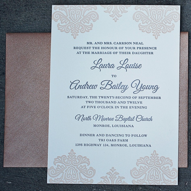 Laura and Andrew chose elegant invitations with pale pink damask print and formal navy typeface.