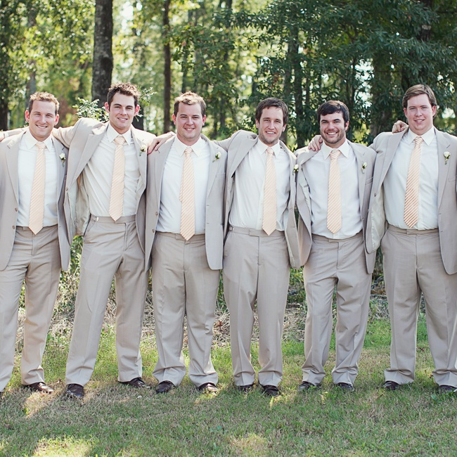 Andrew and his groomsmen wore relaxed neutral suits, classic white shirts and yellow striped ties.