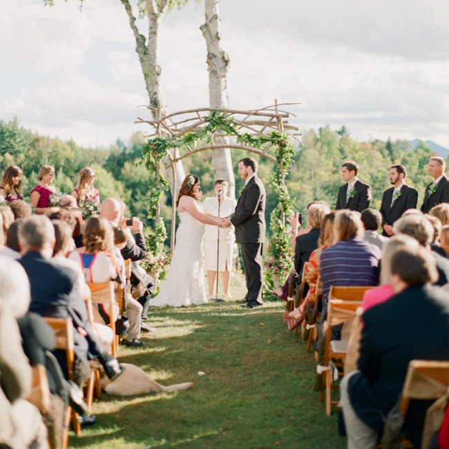 When the couple visited The Mountain House and saw the amazing view overlooking Keene Valley, they knew it was the right place. They used a branch pergola and draped 20 feet of lemon leaf garland on it.