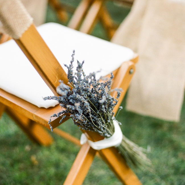 The couple's sisters tied bunches of dried lavender to the chairs along the aisle.