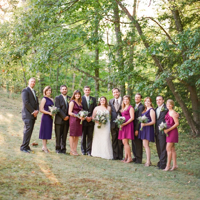 Each bridesmaid chose her own short purple dress with neutral shoes. The groomsmen wore dark brown suits with forest green vests.