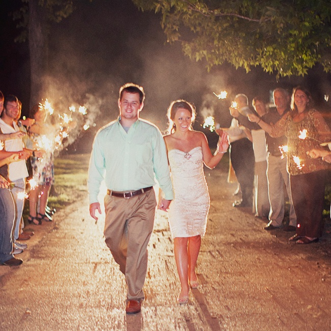 The couple's family and friends sent them off in style with bright sparklers.