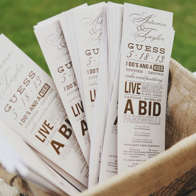 The ceremony programs employed different font types in a neutral color palette.