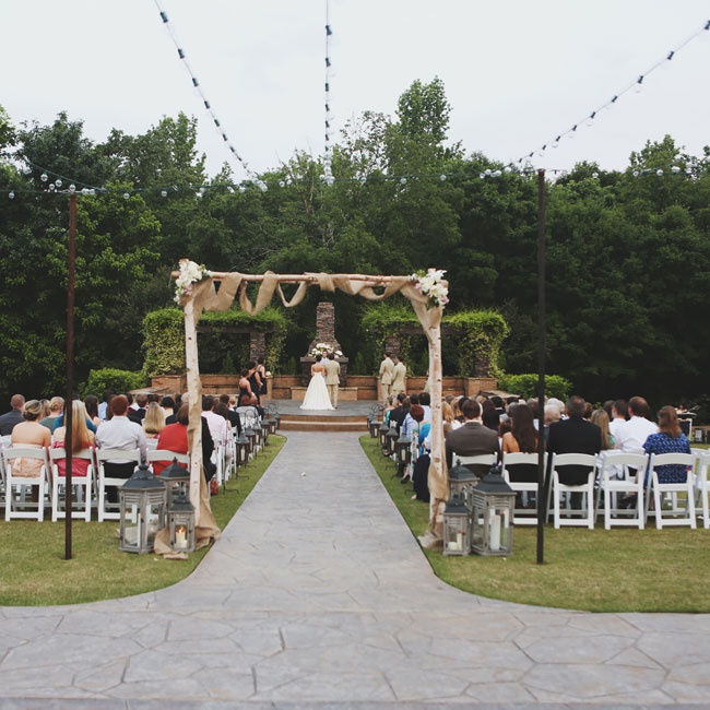 The bride and groom exchanged vows in an outdoor ceremony at The Sonnet House in Leeds, AL.