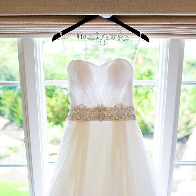 Allison accented her gown with a satin sash beaded and crystal embellishments.