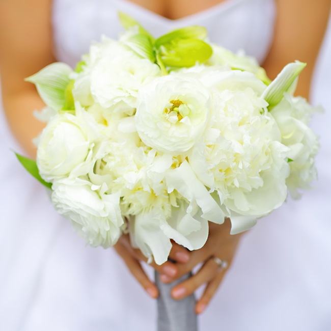 Peonies, ranunculuses and roses, all in a soft shade of ivory, filled Allison's bridal bouquet.
