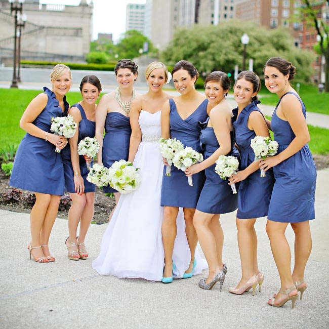 The bridesmaids wore royal blue dresses in a variety of styles and their own heels.