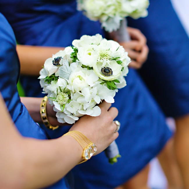 The bridesmaids carried bouquets filled with a unique mix of ivory blooms, including anemones, ranunculuses and scabiosas. Lamb's ear added a subtle hint of color to the bouquets.