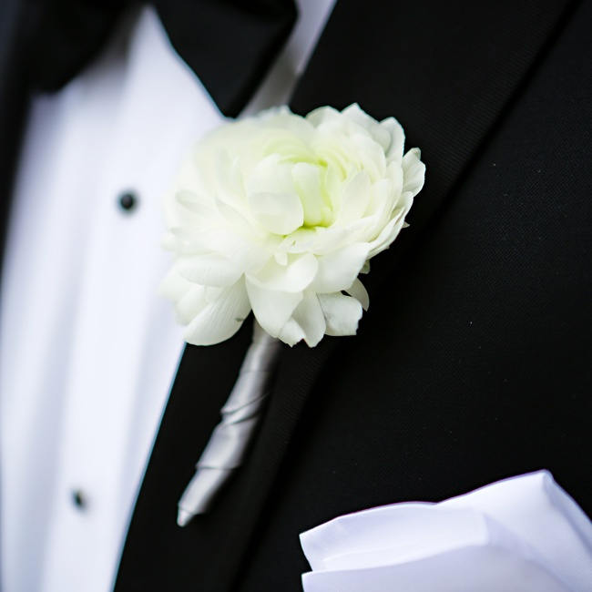 Brandon's simple ivory boutonniere popped against his black tuxedo.