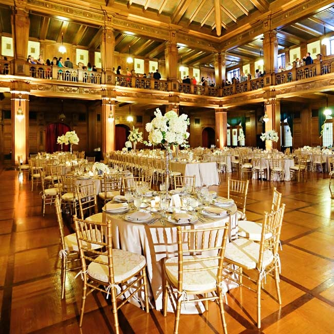 An ivory, gold and royal blue color palette complemented the venue's opulent gold accents and transformed the dramatic venue into an elegant, regal feeling affair.