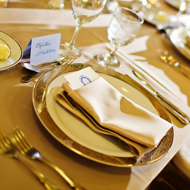 Golden linens, silverware and gold-trimmed plates gave the place settings an elegant, regal air.