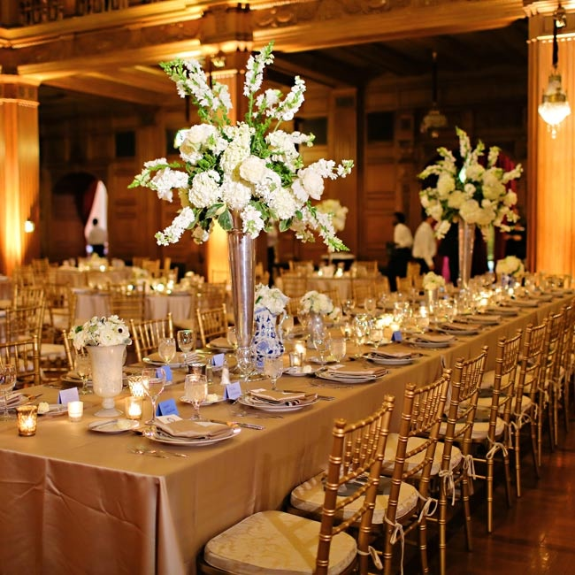 Lavish bunches of hydrangeas and snapdragons filled golden trumpet-style vases that were places along long tables covered in gold linens.