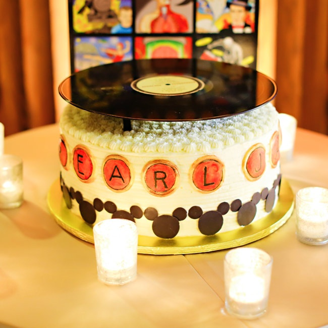 The groom's cake was decorated to look like a record player and was even topped with a real record.