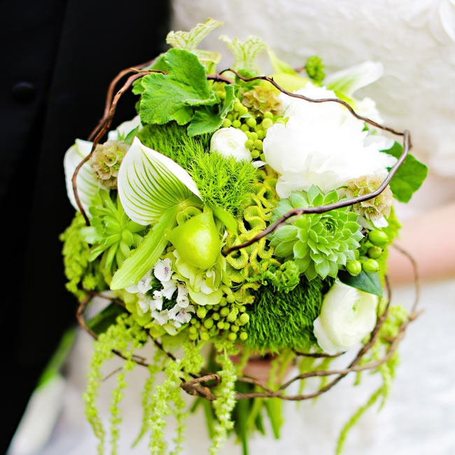 Brittany's statement bouquet was filled with a variety of bright green textured blooms including coxcomb, succulents and hypernicum berries. The rounded bouquet was accented by dark vines woven throughout.