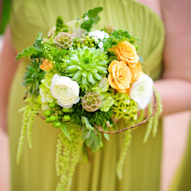 Orange and white cabbage roses were woven into the bridesmaids' textured bouquets that had a variety of unique elements including succulents, scabiosa pods, coxcomb and amaranthus.