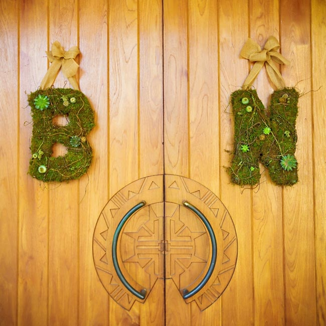 The museum doors were decorated with moss letters - a b and an n - the first letters of the couple's names.