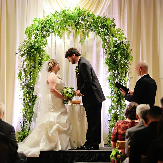 A lush green wedding arch served as the backdrop for Brittany and Nick's ceremony.