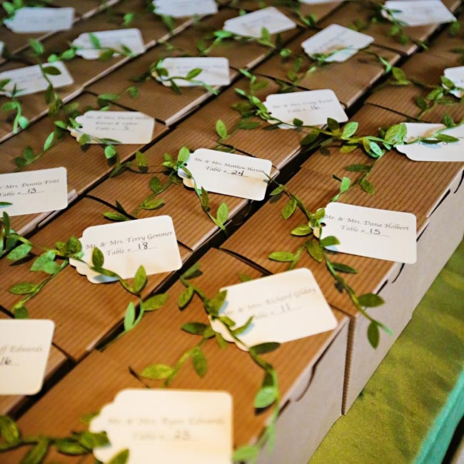 The escort cards doubled as favors and were tied with ribbon that looked like leafy vines.