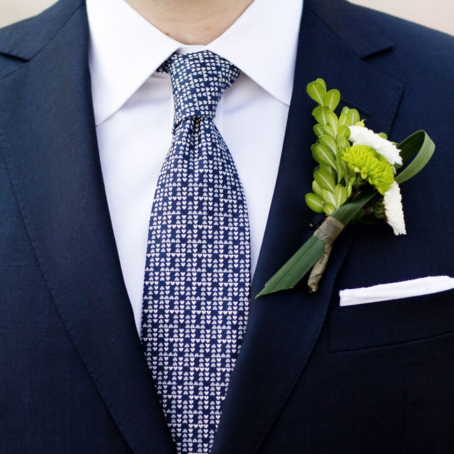 The groom paired his unique boutonniere with a patterned blue and white Hermes tie.