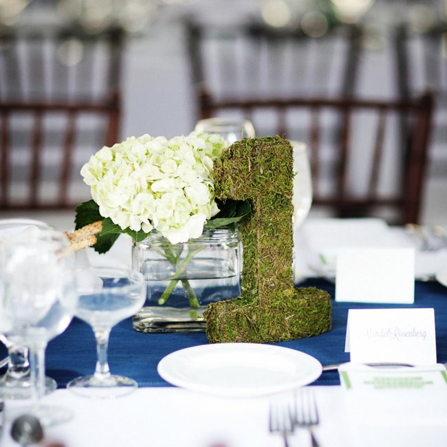 Table names were displayed in green moss numbers that sat near the tables' centerpieces.