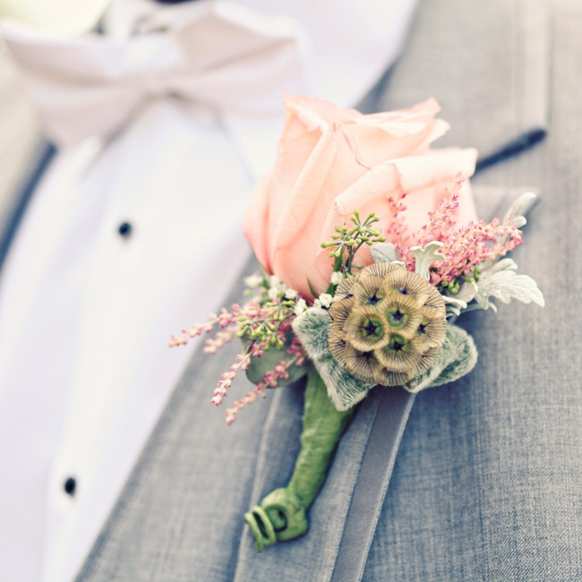 Groomsmen wore soft pink boutonnieres accented with subtle, textured scabiosa pods.