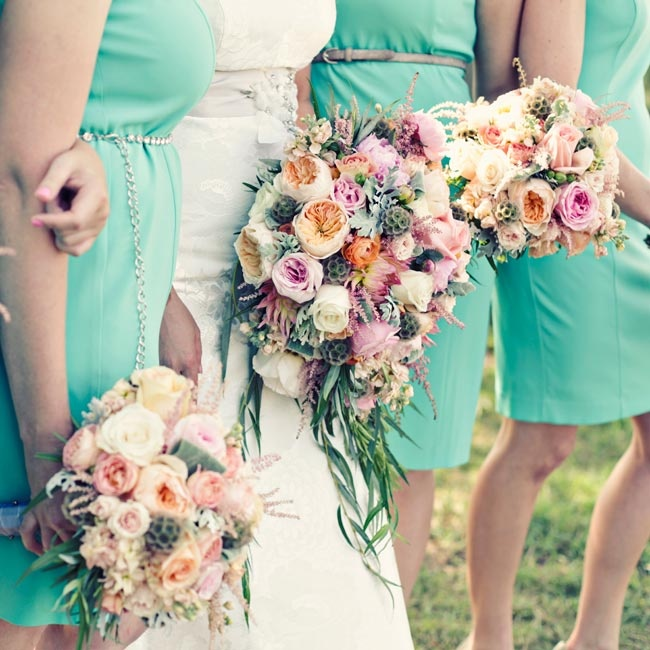 Both the bridesmaids and the bride carried vibrant pink and orange bouquets of peonies and roses mixed with the more textured scabiosa pods.