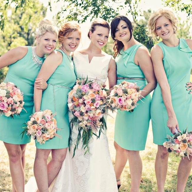 Bridesmaids wore mint colored Ann Taylor bridesmaid dresses with looser, low updos.