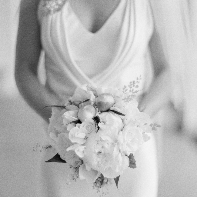 Bridget's all-white bouquet was filled with peonies, garden roses, freesias and touches of greenery.