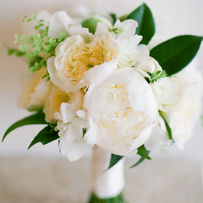 The bride's bouquet was a fluffy combination of peonies, roses and greenery.