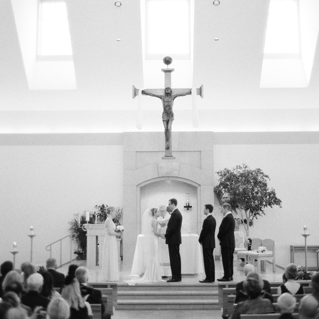 "The couple were married in the Catholic church that Bridget grew up in. ""We didn't decorate the space at all! We felt that it was perfect just as it was,"" says Bridget."