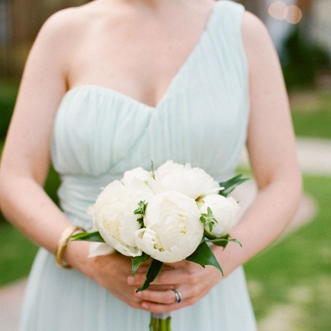 Bridget's sister carried an all-white bouquet of peonies.