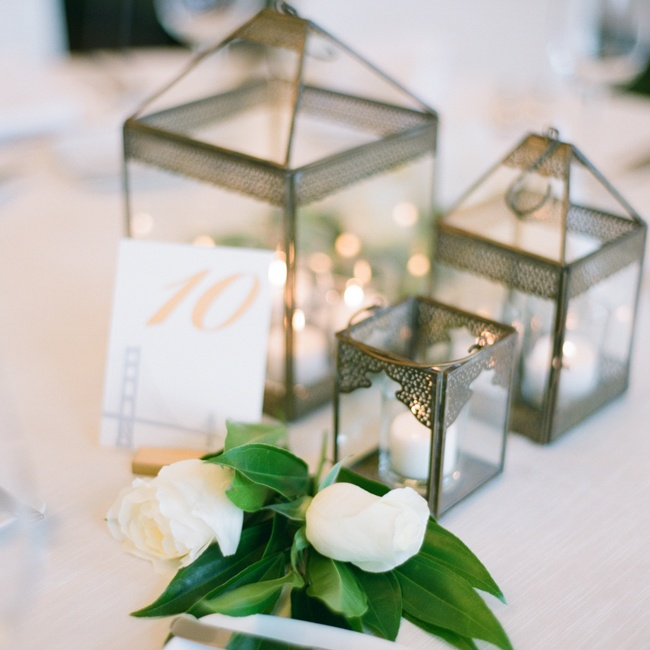 Metal lanterns with small white votive candles inside topped the reception tables.