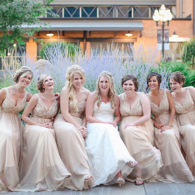 Callie's six bridesmaids wore long champagne chiffon dresses with a sequined bodice. Her maid of honor wore a similar strapless dress.