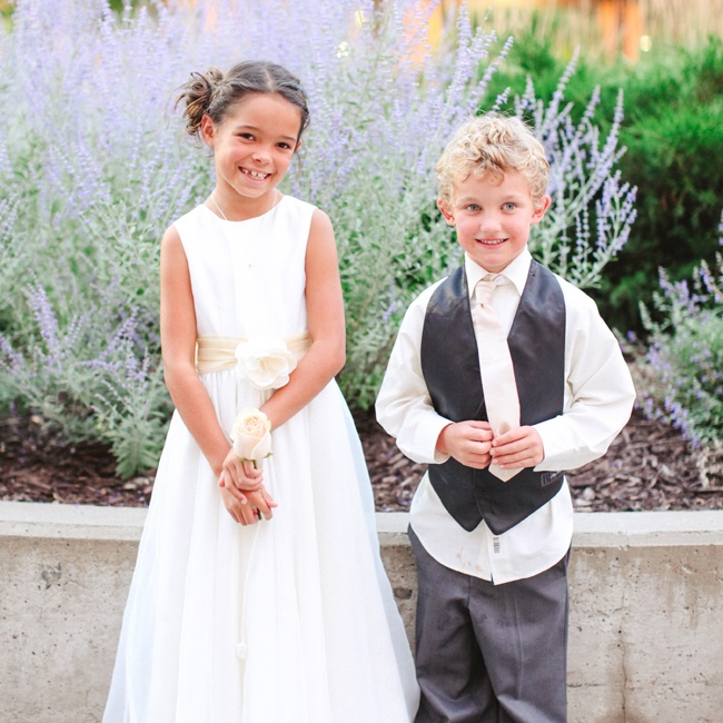 The flower girl wore an ivory dress with a champagne colored sash to match the bridesmaid dresses. The ring bearer wore a Vera Wang tuxedo that matched the groomsmen.