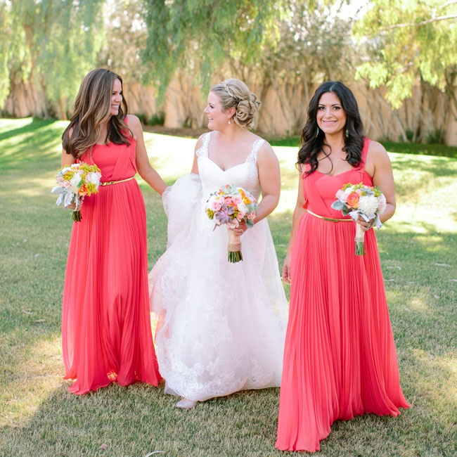 Bridesmaids wore bright coral floor-length maxi dresses from oasis.andotherbrands.com.