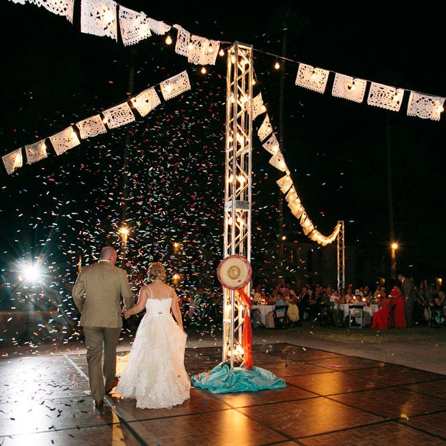 The couple set reception tables around a wooden dance floor with a large southwestern centerpiece.