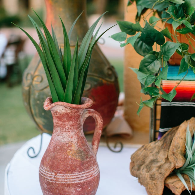 The couple was inspired by various Southwestern plants and featured them throughout the ceremony and reception, including as table names, centerpieces and even as favors for guests.