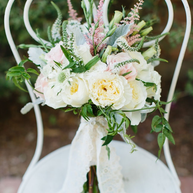 Emily's bouquet was textured with veronica and scabiosa flowers with a base of peonies and roses.