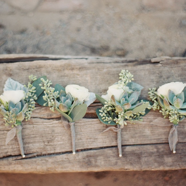 The groomsmen accessorized with delicate white and green boutonnieres.