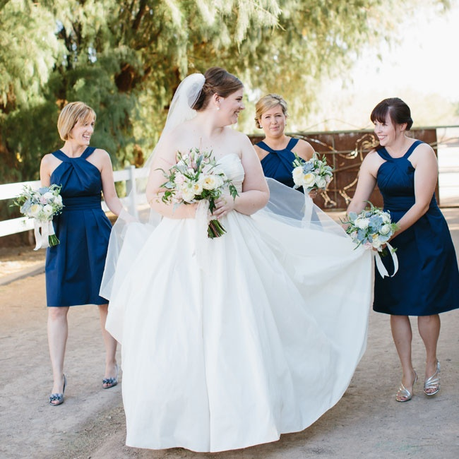 Bridesmaids wore short navy blue dresses from David's Bridal while the bride wore a voluminous Galina gown.