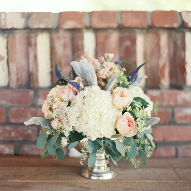Reception decor included silver vases filled with soft pink roses and white hydrangeas.