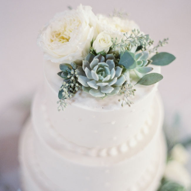 The couple's traditional white, tiered cake was accented with dots and topped with fresh peonies and succulents.