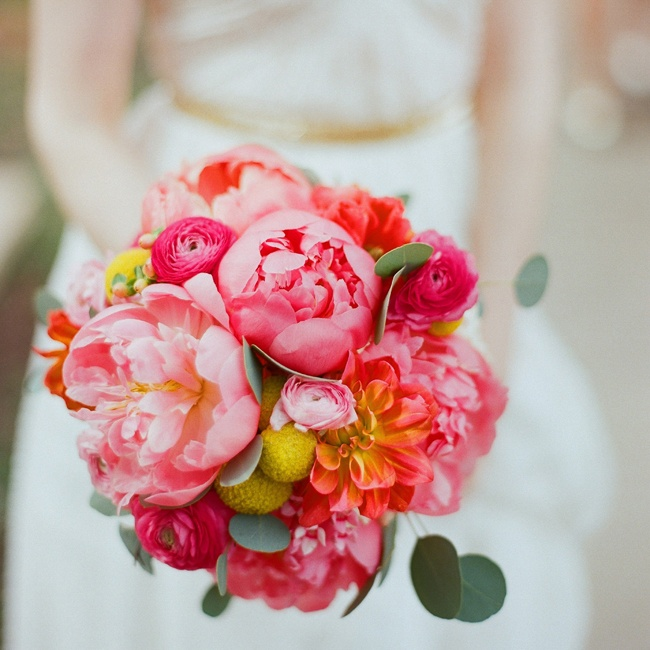 Katie's bright bouquet was made up of coral peonies, dahlias, ranunculus and yellow craspedia.
