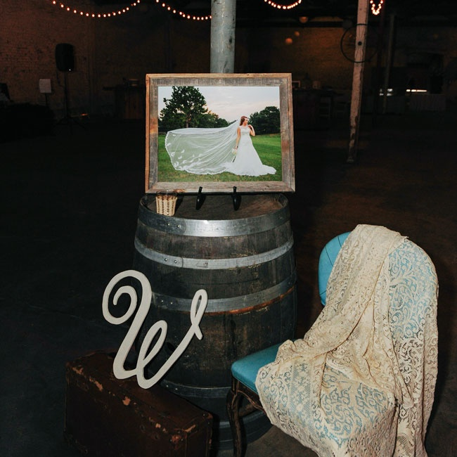 A major decorating theme for the couple was a rustic wine barrels, lace and vintage elements.