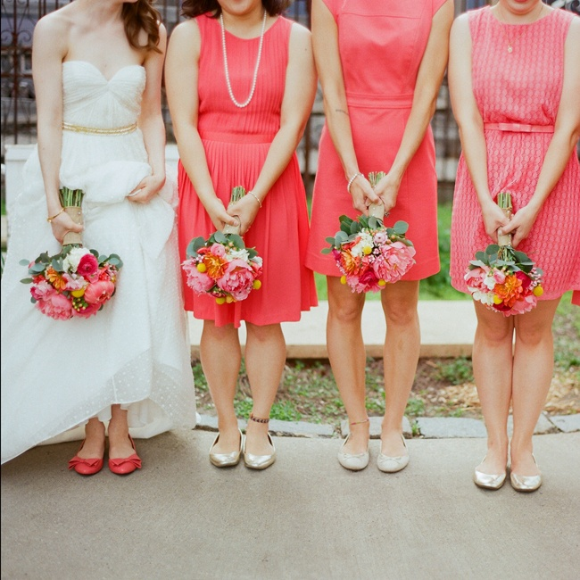 "All of the bridesmaid dresses followed a similar concept: coral color, around knee length and not too much detail. ""It allowed for each girl to pick a dress that suited her physique and her style, which I loved,"" says Katie."