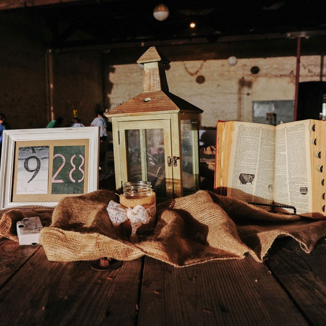 Wedding decor included vintage lanterns and books as well as plenty of burlap and lace.