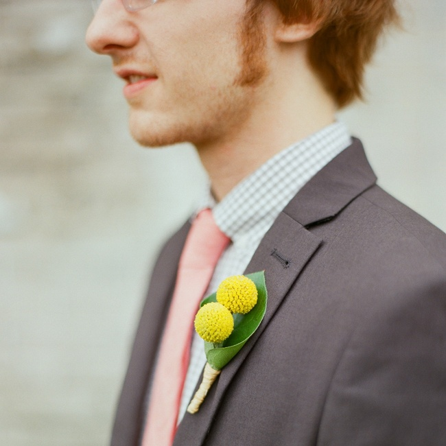 The groom wore billy balls on his lapel.